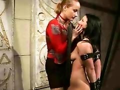 Fashionable mistress painfully punishing her slavegirl