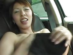 Asian chick gets horny in the car and plays with her pussy