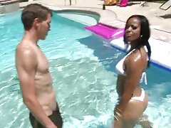 Amazing mulatto chick having interracial sex by the poolside