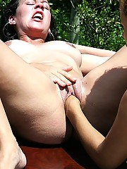 Curvy Latina dyke fisting her girlfriend outside in the sun